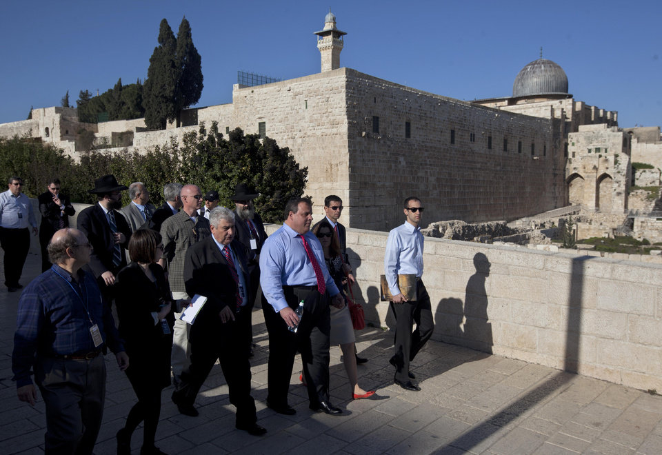 Photo -   Backdropped by the Al Aqsa Mosque compound New Jersey Gov. Chris Christie, third from the right, walks during his visit to Jerusalem's old city Monday, April 2, 2012. Christie kicked off his first official overseas trip Monday meeting Israel's leader in a visit that may boost the rising Republican star's foreign policy credentials ahead of November's presidential election. (AP Photo/Sebastian Scheiner)