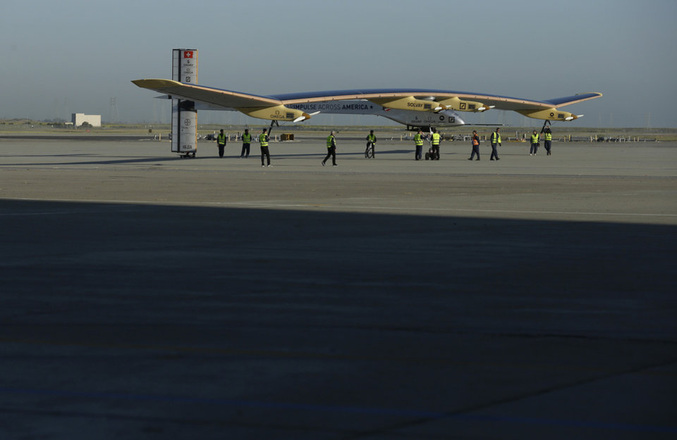 The Solar Impulse is seen after landing from a test flight at Moffett Field NASA Ames Research Center in Mountain View, Calif., Friday, April 19, 2013. A solar-powered plane that has wowed aviation fans in Europe is set to take an early morning test flight over the San Francisco Bay area. Considered the world\'s most advanced sun-powered plane, the Solar Impulse is set to take off from Moffett Field in Mountain View at first light for a two-hour practice run leading up to the start of a multi-city, cross-country tour. (AP Photo/Jeff Chiu)