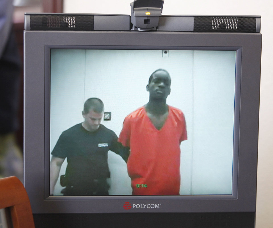 Photo - Lester Kinchion, right, is shown Wednesday during his video arraignment before Oklahoma County Special Judge Russell Hall. PHOTO BY STEVE GOOCH, THE OKLAHOMAN