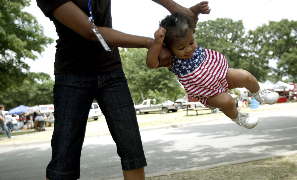 Jesse Hardiman swings Ava Welch, 1, during Bethany's Centennial Freedom Festival, Saturday,  July 4, 2009, at Eldon Lyon Park in Bethany, Okla. Photo by Sarah Phipps, The Oklahoman