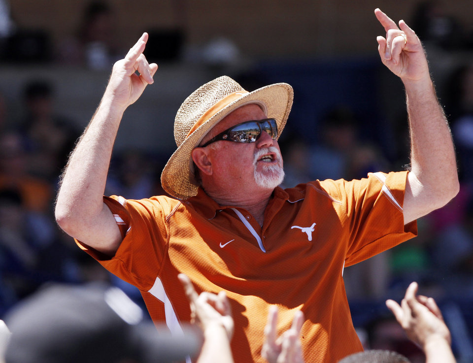 Photo - Texas fan Rick McFalls from Dallas, Texas leads fans in the