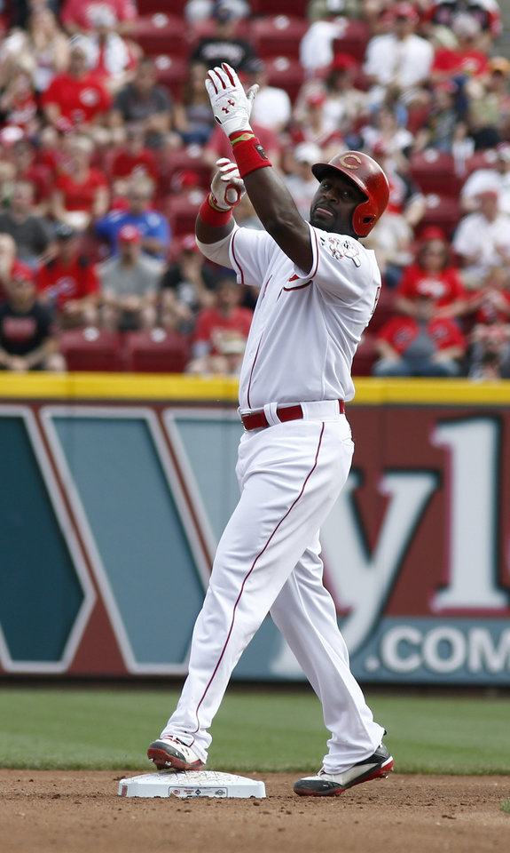 Photo - Cincinnati Reds' Brandon Phillips points to the sky after hitting a double off Milwaukee Brewers starting pitcher Kyle Lohse during the fourth inning of a baseball game, Sunday, May 4, 2014, in Cincinnati. (AP Photo/David Kohl)