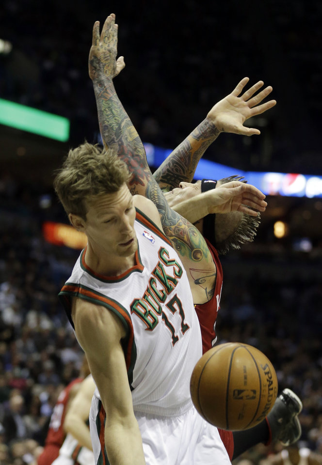 Photo - Milwaukee Bucks' Mike Dunleavy (17) is fouled by Miami Heat's Chris Andersen as they go after a rebound during the first half of Game 3 in their first-round NBA basketball playoff series on Thursday, April 25, 2013, in Milwaukee. (AP Photo/Morry Gash)
