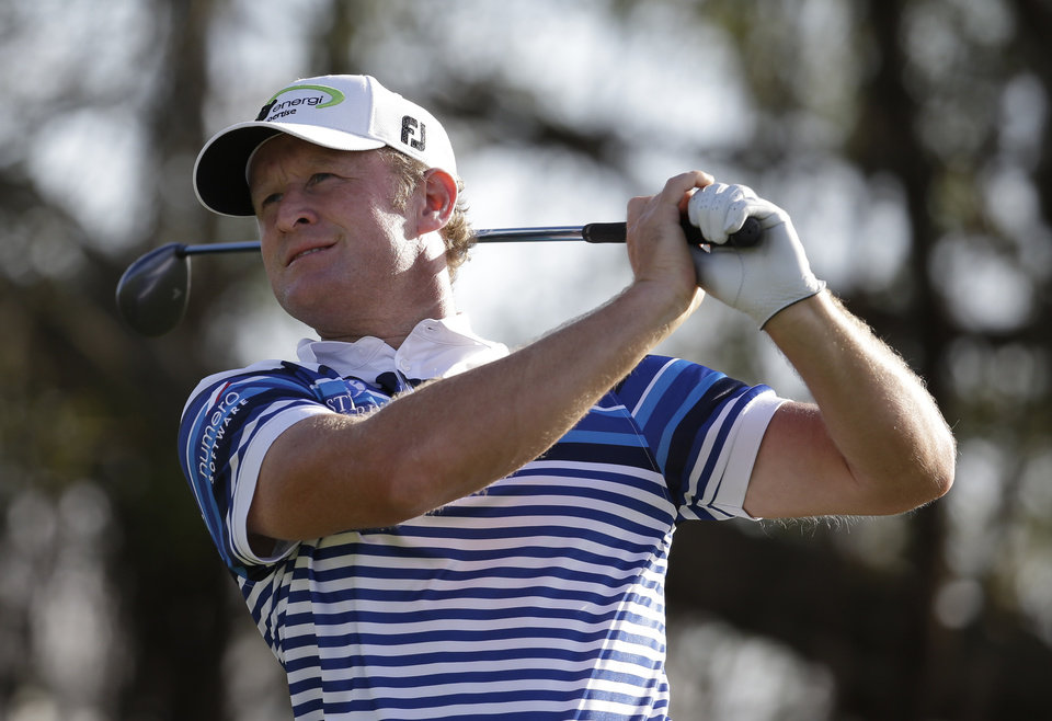Photo - Jamie Donaldson watches his shot from the fifth tee during the second round of the Cadillac Championship golf tournament Friday, March 7, 2014, in Doral, Fla. (AP Photo/Lynne Sladky)