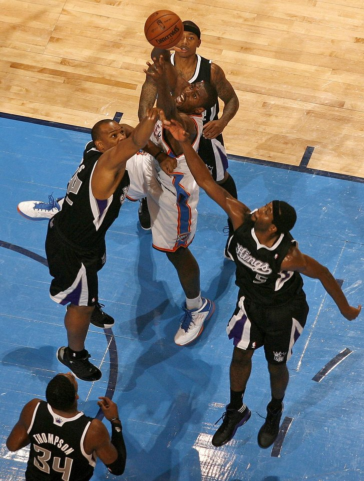 Oklahoma City's Serge Ibaka (9) goes for the ball between Sacramento's Chuck Hayes (42), John Salmons (5), and Isaiah Thomas (22) during an NBA basketball game between the Oklahoma City Thunder and the Sacramento Kings at Chesapeake Energy Arena in Oklahoma City, Friday, Dec. 14, 2012. Photo by Bryan Terry, The Oklahoman
