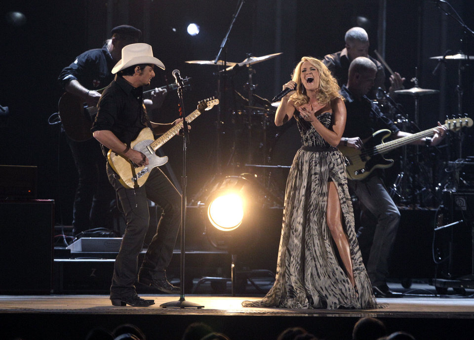 Photo - Brad Paisley, left, and Carrie Underwood perform