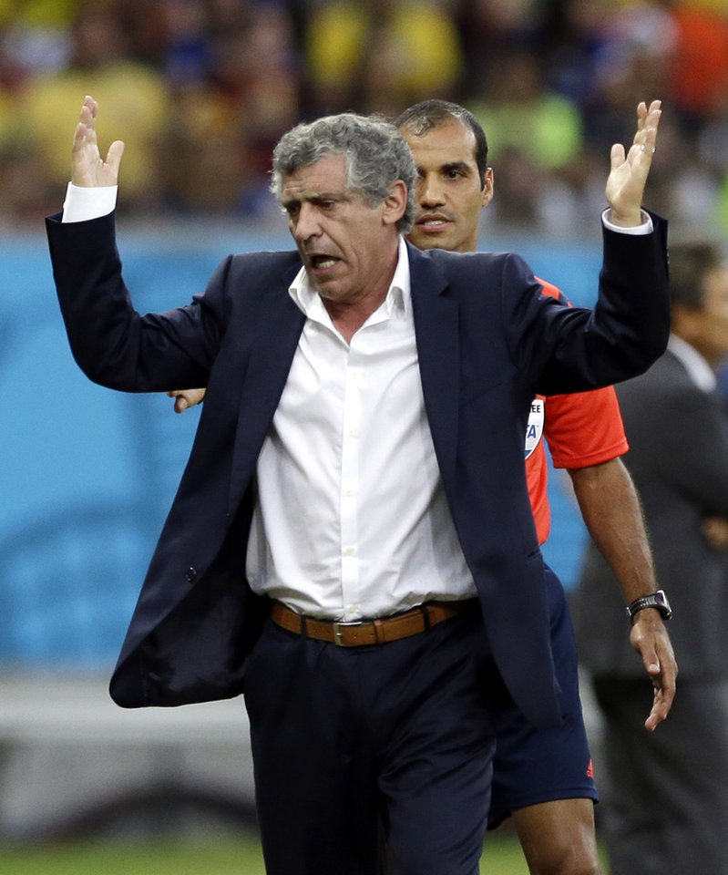 Photo - Greece's head coach Fernando Santos gestures during the World Cup round of 16 soccer match between Costa Rica and Greece at the Arena Pernambuco in Recife, Brazil, Sunday, June 29, 2014. (AP Photo/Ricardo Mazalan)