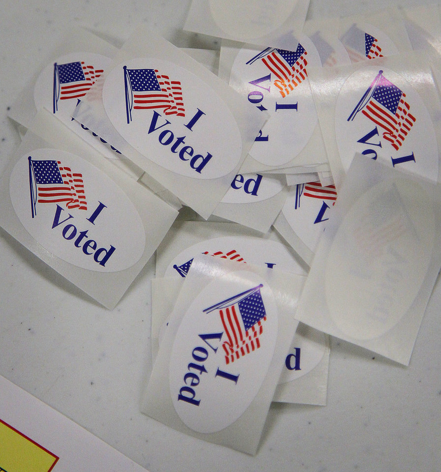 Voters get a sticker indicating that they voted at the precinct 1012 in the Handley-Meadowbrook Community Center, Tuesday, Nov. 6, 2012 in Fort Worth, Texas. (AP Photo/The Fort Worth Star-Telegram, Rodger Mallison) MAGS OUT; (FORT WORTH WEEKLY, 360 WEST); INTERNET OUT
