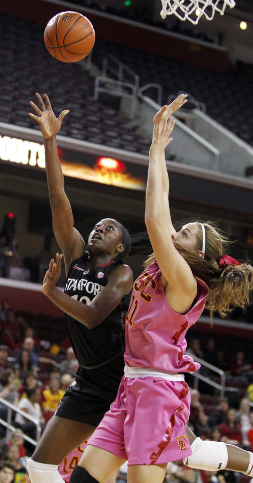 Photo - Stanford forward Chiney Ogwumike, left, releases a shot against Southern California forward Cassie Harberts (11) during the first half of an NCAA college basketball game Friday, Feb. 21, 2014, in Los Angeles. (AP Photo/Alex Gallardo)