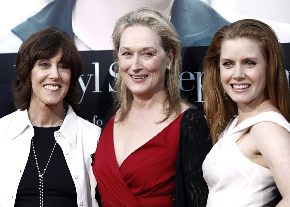 Photo -   FILE - This July 27, 2009 file photo shows director and writer Nora Ephron, left, and cast members Meryl Streep, center, and Amy Adams pose together at the premiere of