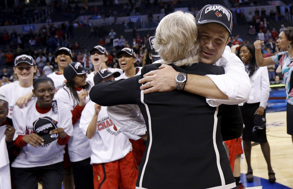 Louisville coach Jeff Walz receives a hug after the Oklahoma City Regional for the NCAA women's college basketball tournament  between the University of Tennessee and Louisville at Chesapeake Energy Arena in Oklahoma City, Tuesday, April 2, 2013. Louisville won 86-78. Photo by Bryan Terry, The Oklahoman