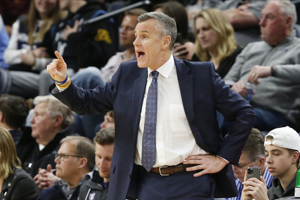 Photo - Oklahoma City Thunder's head coach Billy Donovan directs his team against the Minnesota Timberwolves in the second half of an NBA basketball game Monday, Jan. 13, 2020, in Minneapolis. The Thunder won 117-104. (AP Photo/Jim Mone)