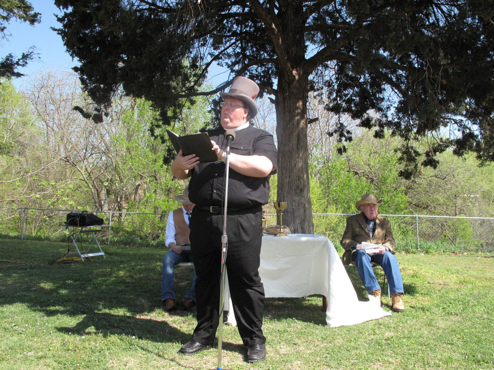 Photo - The Rev. John Malget, senior pastor of First Christian Church of  Oklahoma City (Disciples of Christ), preaches a sermon on April 21 on the lawn of the church, 3700 N Walker. Photo by Carla Hinton, The Oklahoman