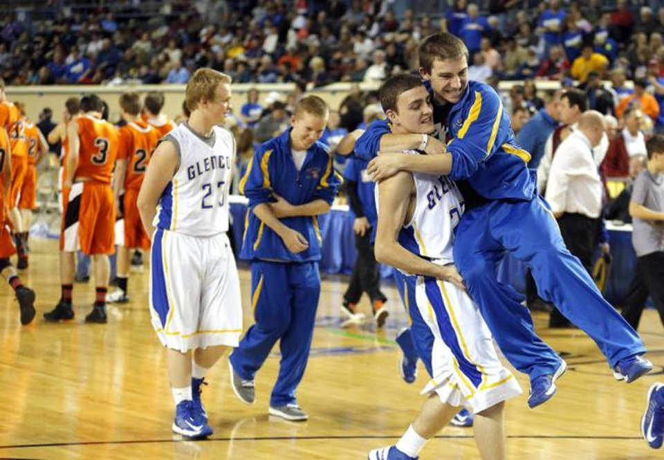 Glencoe\'s Quentin Ash celebrates with Austin Ojala during the Class A boys semifinal game of the state high school basketball tournament between Glencoe and Sterling at the State Fair Arena., Friday, March 1, 2013. Photo by Sarah Phipps, The Oklahoman