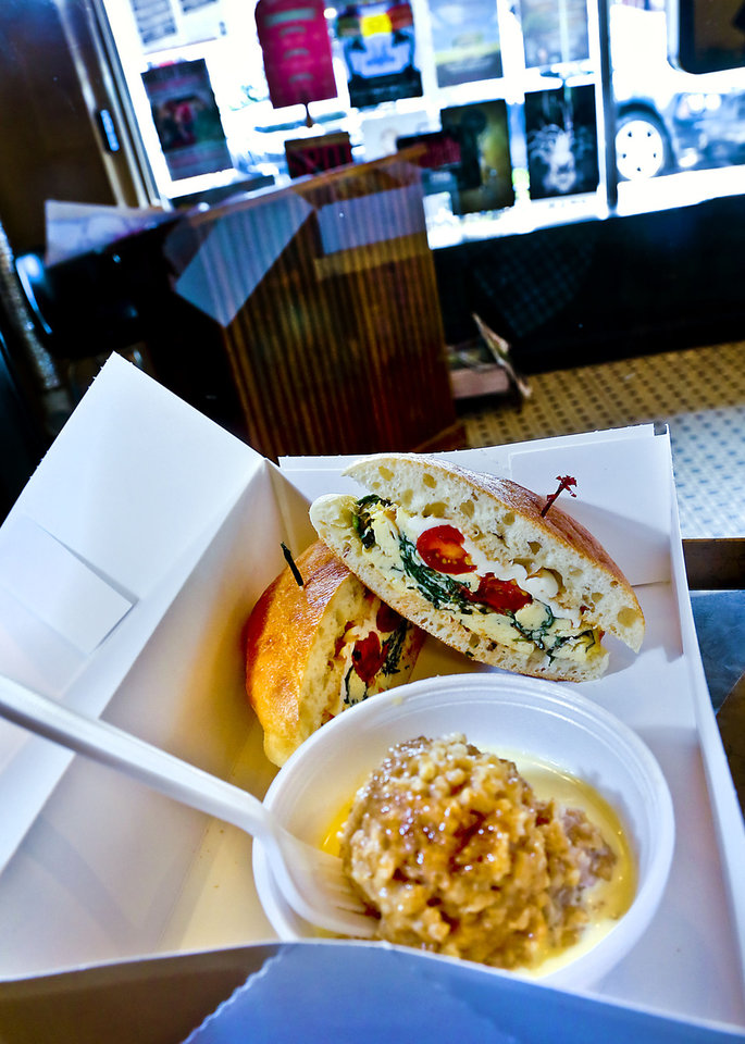 Photo - VZD'S BOX LUNCH: Egg Florentine sandwich and steel cut oats to go.  Photo by Chris Landsberger, The Oklahoman  CHRIS LANDSBERGER - CHRIS LANDSBERGER