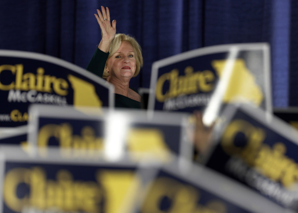Photo -   Sen. Claire McCaskill, D-Mo., waves to the crowd as she walks on stage to declare victory over challenger Rep. Todd Akin, R-Mo., in the Missouri Senate race Tuesday, Nov. 6, 2012, in St. Louis. (AP Photo/Jeff Roberson)