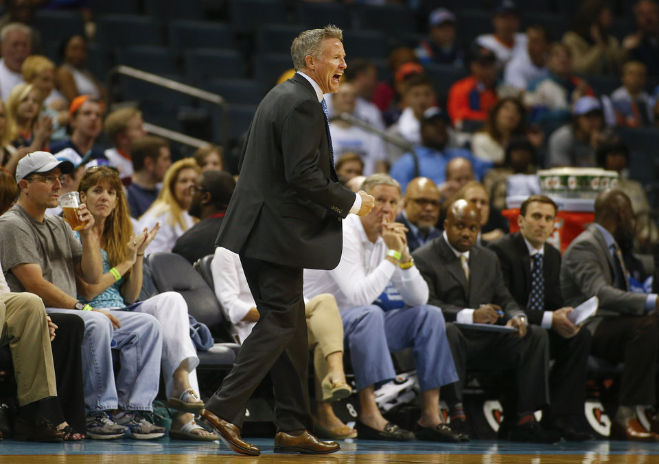 Photo - Philadelphia 76ers head coach Brett Brown reacts as his team takes on the Charlotte Bobcats during the first half of an NBA basketball game in Charlotte, N.C., Saturday, April 12, 2014. (AP Photo/Chris Keane)