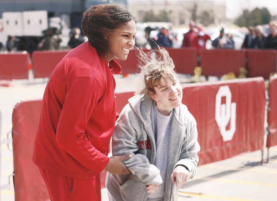 Courtney Paris takes a picture with fan Tiffany England before the Sooners left for St. Louis.  Photo by paul hellstern, the oklahoman