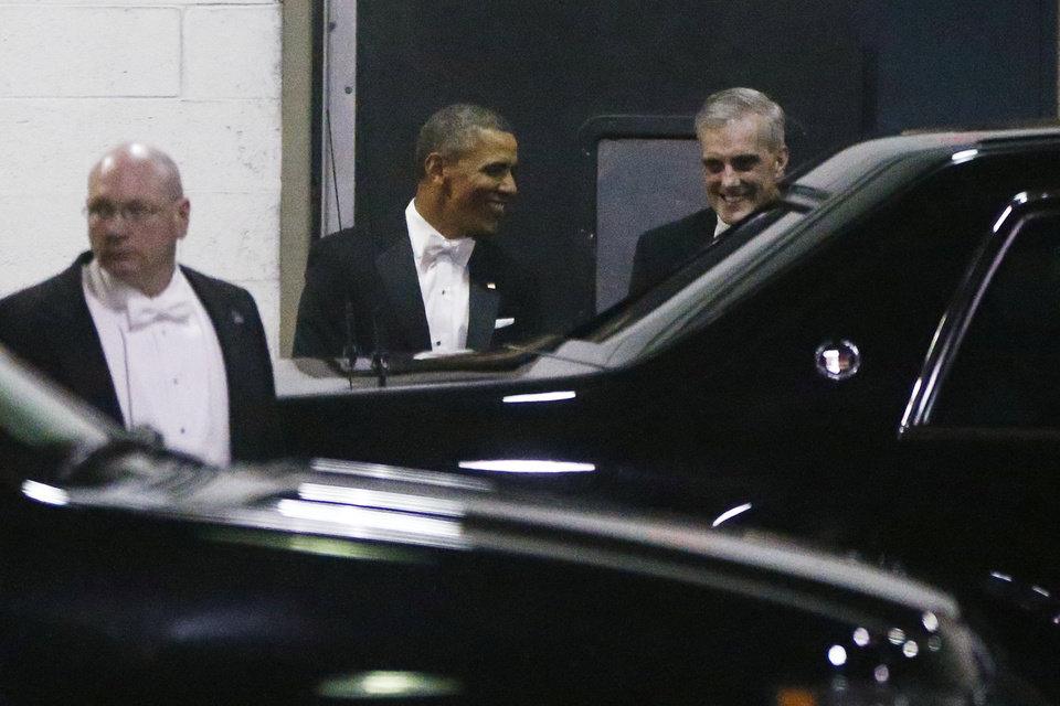 President Barack Obama walks with Chief of Staff Denis McDonough, right, as they leave the Gridiron Dinner through a loading area at a hotel in Washington, Saturday, March 9, 2013. (AP Photo/Charles Dharapak)