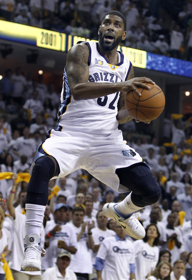 Photo - Memphis Grizzlies guard O. J. Mayo drives against the Oklahoma City Thunder during the first half of Game 4 of a second-round NBA basketball playoff series on Monday, May 9, 2011, in Memphis, Tenn. (AP Photo/Wade Payne)