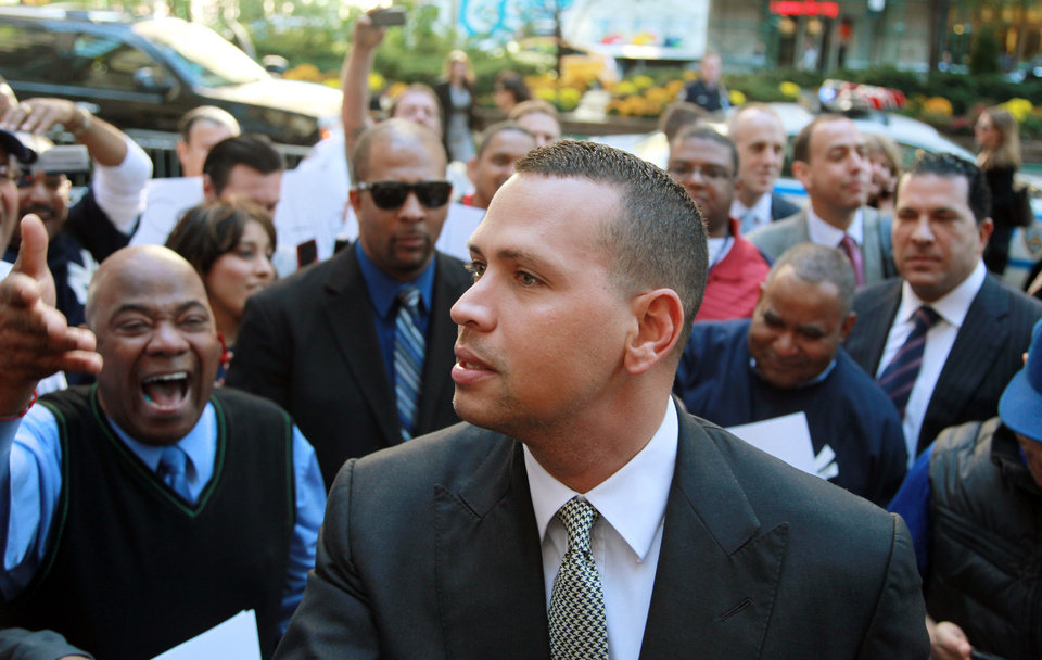 Photo - FILE - In this Oct. 1, 2013, file photo, New York Yankees' Alex Rodriguez arrives at the offices of Major League Baseball in New York.  Rodriguez's drug suspension has been cut to 162 games from 211 by arbitrator Fredric Horowitz, a decision sidelining the New York Yankees third baseman the entire 2014 season. (AP Photo/David Karp, File)
