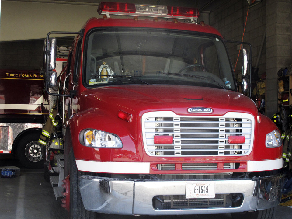 Photo - A structure fire engine similar to the one involved in a fatal crash in Montana is parked inside the Three Forks, Montana, Fire Department on June 20, 2014. The fire engine driven by Three Forks Volunteer Fire Department Chief Todd Rummel was heading east on U.S. Highway 12 when it collided with the westbound pickup about 10 miles east of Helena, forcing both vehicles into a ditch, authorities said. Killed in the pickup were a Helena couple and their three young children, Montana Highway Patrol Capt. Gary Becker said. Their names and ages were not immediately released. (AP Photo/Matt Volz)