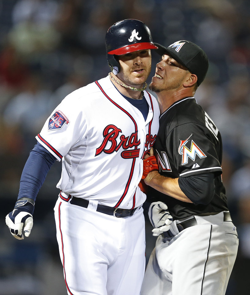 Photo - Atlanta Braves pinch hitter Ryan Doumit (4) is tagged out by Miami Marlins starting pitcher Jose Fernandez (16) after hitting a ground ball to Fernandez in the eight  inning of a baseball game Tuesday, April 22, 2014 in Atlanta.  (AP Photo/John Bazemore)