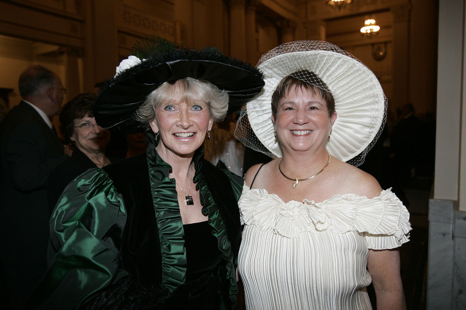 Photo - Pam Daniels, left, of Guthrie, joins Linda Northup, of Guthrie, at the Oklahoma Centennial Statehood Inaugural Ball, Saturday, Nov. 17, 2007, at the Guthrie Scottish Rite Masonic Center, in Guthrie, Okla. By Bill Waugh, The Oklahoman