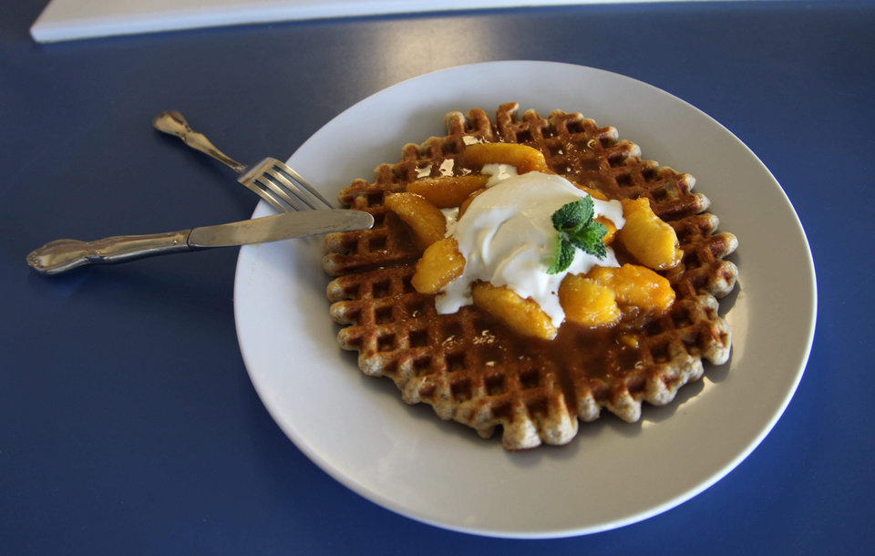 Photo - In this photo taken Friday June 7, 2013 in Del Rey, Calif. shown is a multigrain waffle with sauted peaches, one of the recipes in the Masumoto family cookbook. The Masumotos, who grow peaches and nectarines on an 80-acre farm near Fresno, have published the cookbook to tell the story of their farm and create a stronger link with consumers. (AP Photo/Gosia Wozniacka)