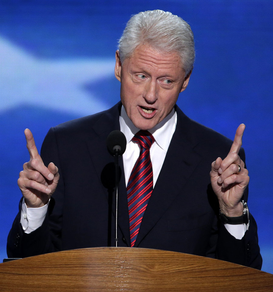Photo - Former President Bill Clinton addresses the Democratic National Convention in Charlotte, N.C., on Wednesday, Sept. 5, 2012. (AP Photo/J. Scott Applewhite)  ORG XMIT: DNC179