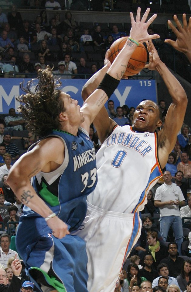 Photo - FIRST REGULAR SEASON WIN: Oklahoma City's Russell Westbrook tries to shoot over Mike Miller of Minnesota during the NBA basketball game between the Oklahoma City Thunder and the Minnesota Timberwolves at the Ford Center in Oklahoma City, Sunday, Nov. 2, 2008. The Thunder won, 88-85. BY NATE BILLINGS, THE OKLAHOMAN  ORG XMIT: KOD