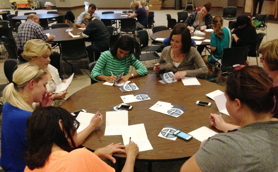 Crossings Community Church volunteers write notes of encouragement to tornado victims during a recent gathering of volunteers at the church, 14600 N Portland. Photo provided <strong></strong>