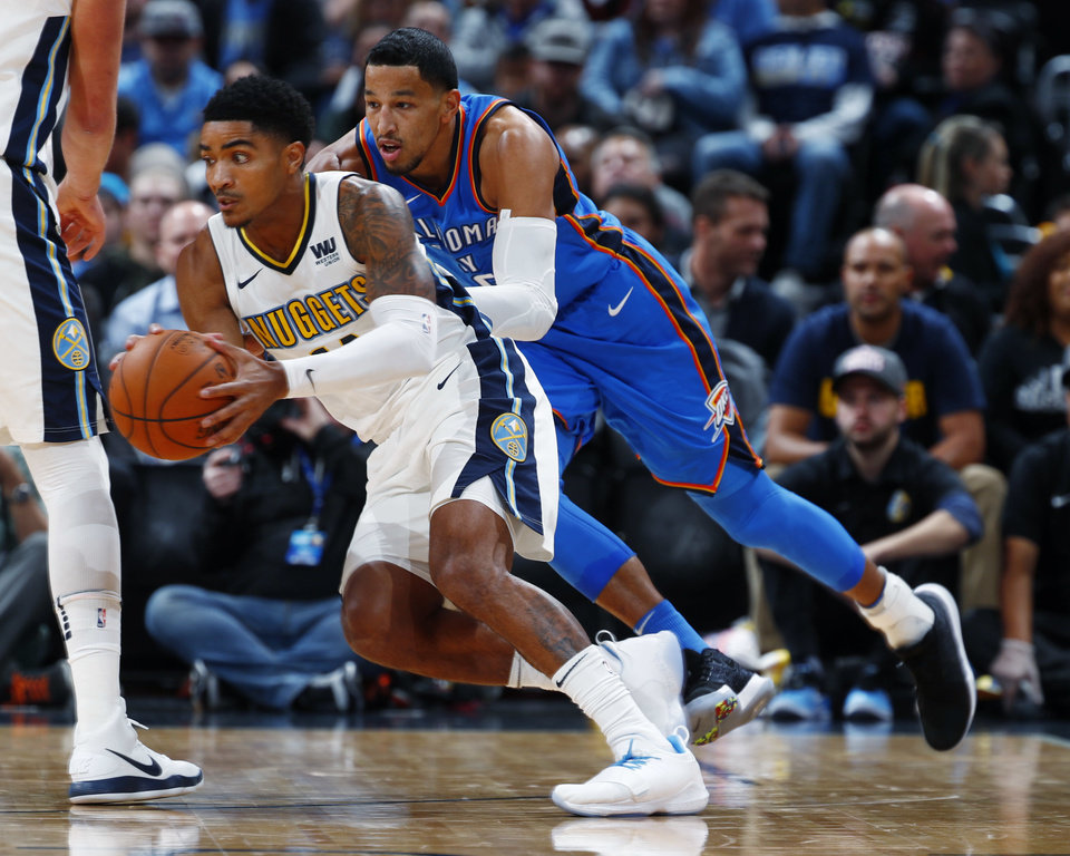 Photo - Denver Nuggets guard Gary Harris, left, drives past Oklahoma City Thunder guard Andre Roberson during the first half of an NBA basketball game Thursday, Nov. 9, 2017, in Denver. (AP Photo/David Zalubowski)