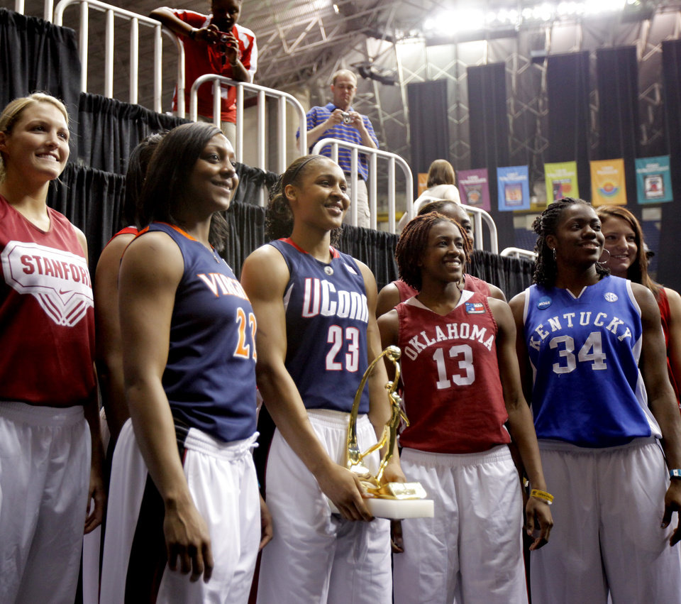 Photo - OU's Danielle Robinson poses with the rest of the All-American team after practice for the Final Four of the NCAA women's  basketball tournament in San Antonio, Texas., on Saturday, April 3, 2010.  The University of Oklahoma will play Stanford on Sunday, April 4, 2010.