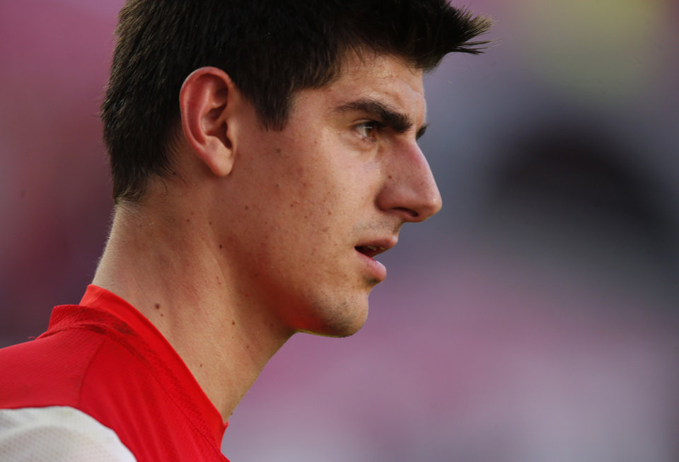 Photo - Atletico goalkeeper Thibaut Courtois looks on, during a training session ahead of Saturday's Champions League final soccer match between Real Madrid and Atletico Madrid, in Luz stadium in Lisbon, Portugal, Friday, May 23, 2014. (AP Photo/Daniel Ochoa de Olza)