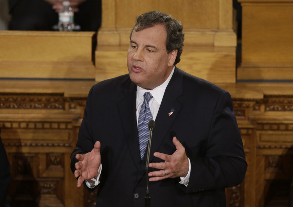 "Photo - New Jersey Gov. Chris Christie delivers his State Of The State address at the Statehouse, Tuesday, Jan. 14, 2014, in Trenton, N.J. Christie apologized again Tuesday, saying his administration ""let down the people we are entrusted to serve"" but that it doesn't define his team or the state. (AP Photo/Mel Evans)"