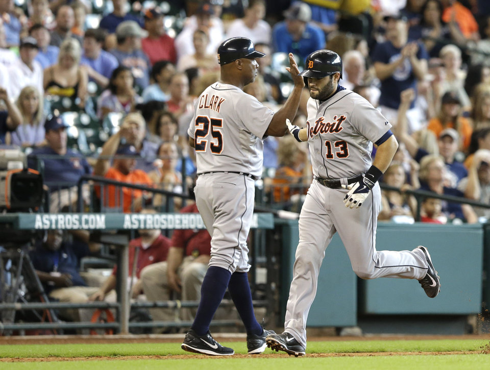 Photo - Detroit Tigers' Alex Avila (13) is congratulated by third base coach Dave Clark (25) as he rounds the bases on a solo homer against the Houston Astros fifth inning of a baseball game Sunday, June 29, 2014, in Houston. (AP Photo/Pat Sullivan)