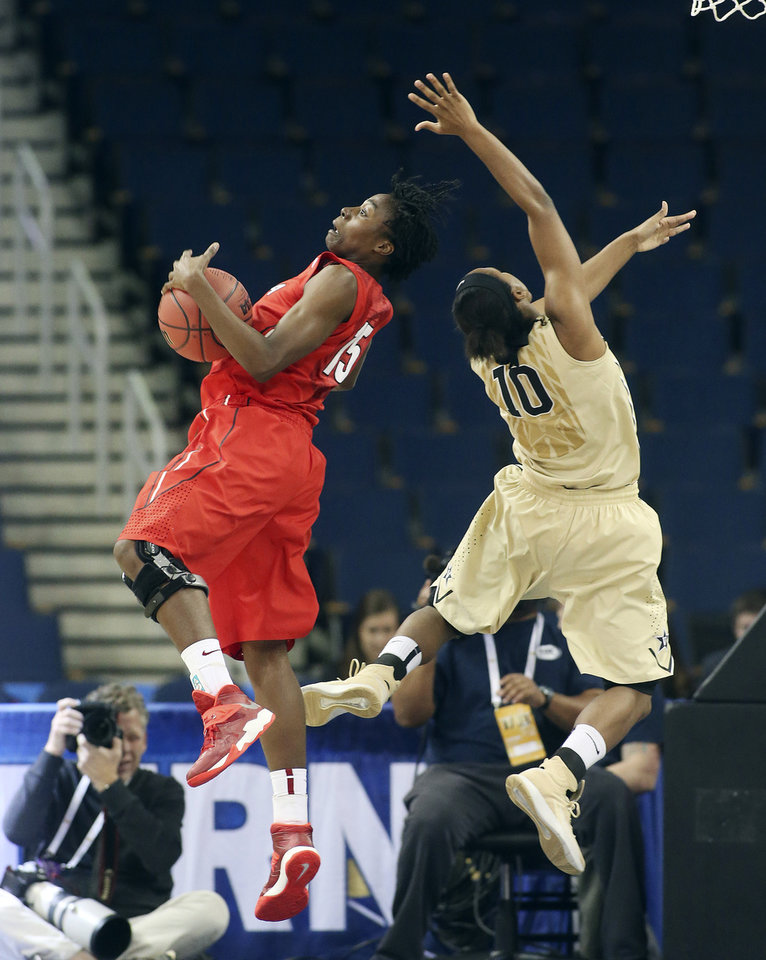 Photo - Georgia's Krista Donald, left, brings down a rebound against Vanderbilt guard Christina Foggie (10) in the first half of a second-round women's Southeastern Conference tournament NCAA college basketball game Thursday, March 6, 2014, in Duluth, Ga.  (AP Photo/Jason Getz)