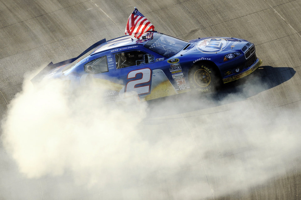 Photo -   Brad Keselowski performs a burnout after winning the NASCAR Sprint Cup Series auto race, Sunday, Sept. 30, 2012, at Dover International Speedway in Dover, Del. (AP Photo/Nick Wass)