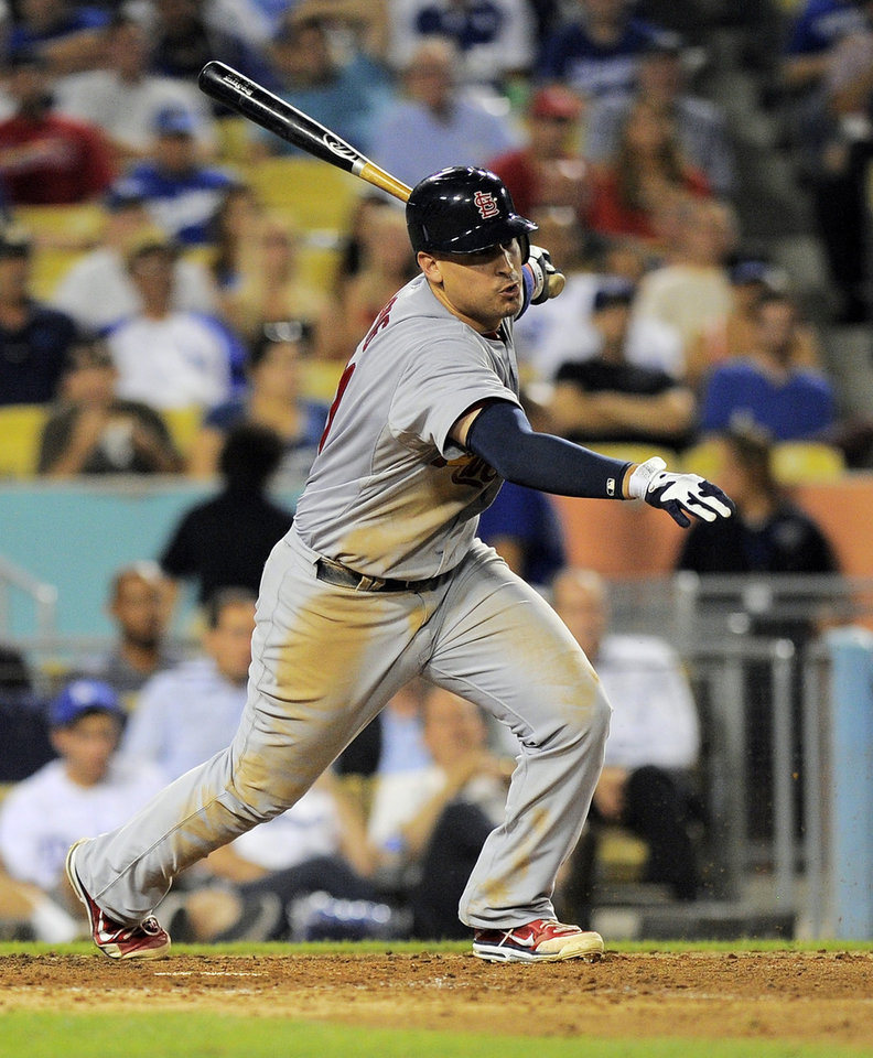 Photo -   St. Louis Cardinals' Allen Craig hits and RBI single during the seventh inning of their baseball game against the Los Angeles Dodgers, Thursday, Sept. 13, 2012, in Los Angeles. (AP Photo/Mark J. Terrill)