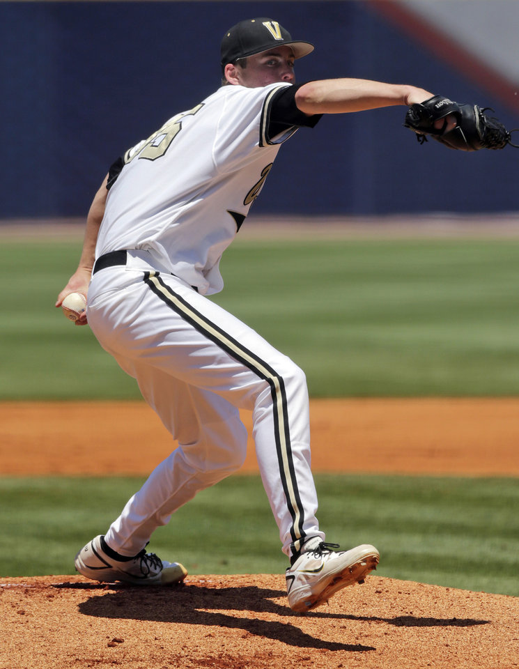 Photo - Vanderbilt's Kevin Ziomek pitches in the first inning of a Southeastern Conference tournament college baseball game against South Carolina at the Hoover Met in Hoover, Ala., Thursday, May 23, 2013. (AP Photo/Dave Martin)