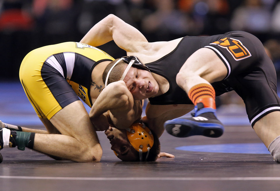 Photo - Oklahoma State's Edeward Klimara takes on Appalachian State's Dominic Parisi in the 125 pound match during the 2014 NCAA Div. 1 Wrestling Championships at Chesapeake Energy Arena in Oklahoma City, Okla. on Thursday, March 20, 2014. Photo by Chris Landsberger, The Oklahoman