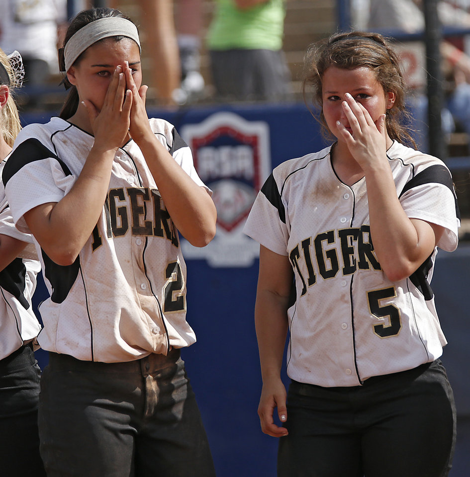 Broken Arrow's Elena Gambill (2) and Caitlin Paolini (5) react after the loss to Tulsa Union in the Class 6A Oklahoma State High School Slow Pitch Softball Championship at ASA Hall of Fame Stadium in Oklahoma City, Wednesday, May 1, 2013. Photo by Chris Landsberger, The Oklahoman