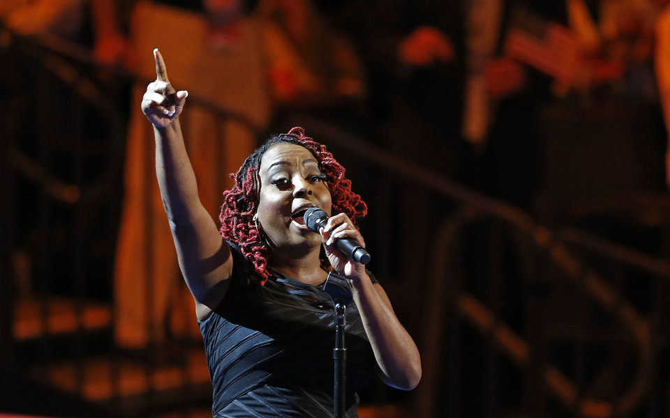 Photo - Singer Ledisi performs during the Democratic National Convention in Charlotte, N.C., on Tuesday, Sept. 4, 2012. (AP Photo/Carolyn Kaster)  ORG XMIT: DNC149