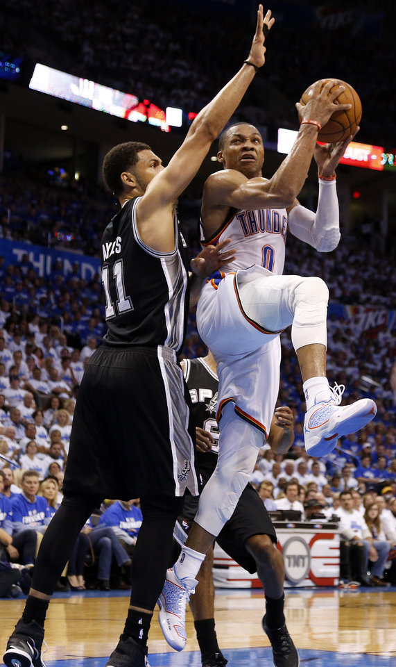 Photo - Oklahoma City's Russell Westbrook (0) goes up for a basket as San Antonio's Jeff Ayres (11) during Game 4 of the Western Conference Finals in the NBA playoffs between the Oklahoma City Thunder and the San Antonio Spurs at Chesapeake Energy Arena in Oklahoma City, Tuesday, May 27, 2014. Photo by Nate Billings, The Oklahoman