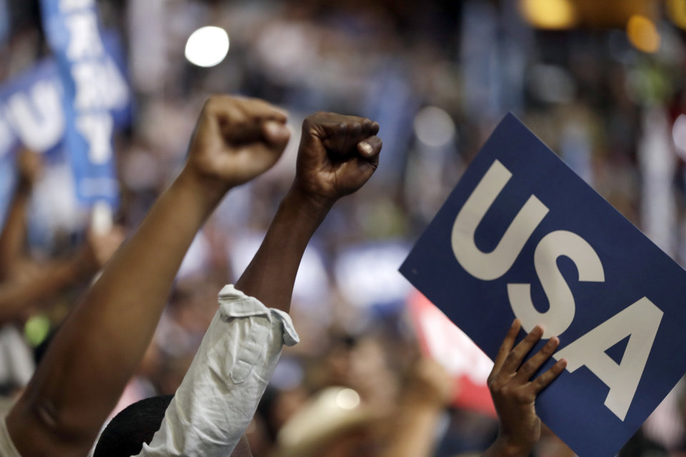 Photo - Delegates raise their fists during the final day of the Democratic National Convention in Philadelphia, Thursday, July 28, 2016. (AP Photo/Matt Rourke)