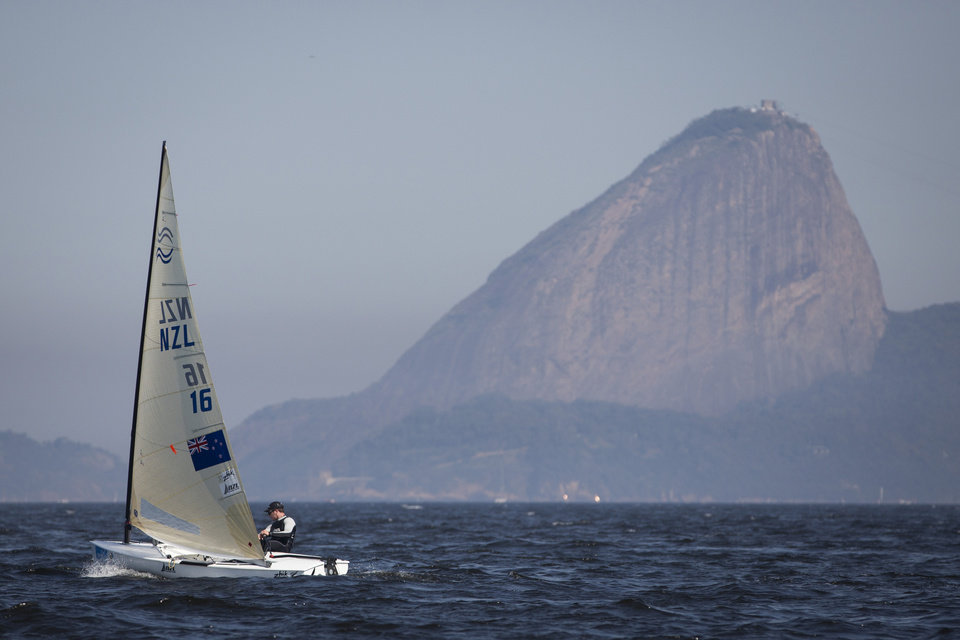 Photo - New Zealand's Finn class Andrew Murdoch competes during the first test event for the Rio 2016 Olympic Games at the Guanabara Bay in Rio de Janeiro, Sunday, Aug. 3, 2014. Sugar Loaf Mountain is seen on the background. American sailing officials have hired medical experts to test the water in Guanabara, which has suffered from decades of untreated human waste being poured into the bay. (AP Photo/Felipe Dana)
