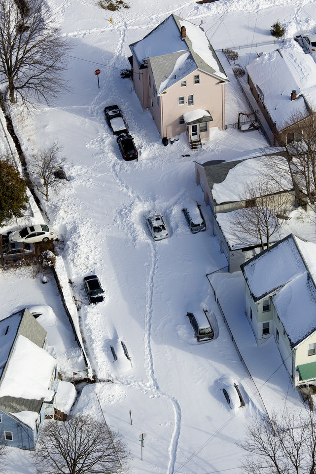 Photo - Neighborhoods and cars are buried in snow near New Haven, Conn., Sunday, Feb. 10, 2013, in the aftermath of a storm that hit Connecticut and much of the New England states. (AP Photo/Craig Ruttle)