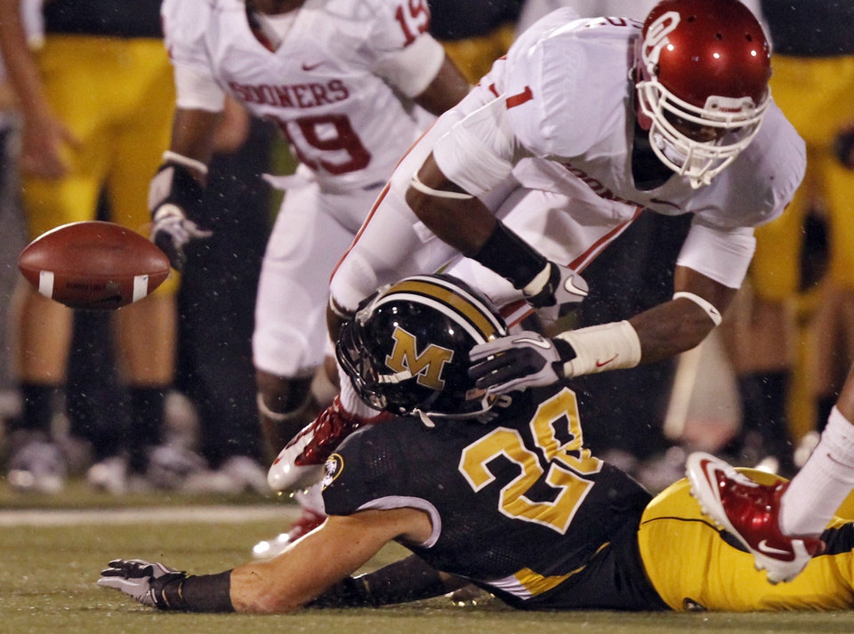 Photo - Oklahoma's Tony Jefferson (1) breaks up a pass for Missouri's T.J. Moe (28)during the first half of the college football game between the University of Oklahoma Sooners (OU) and the University of Missouri Tigers (MU) on Saturday, Oct. 23, 2010, in Columbia, Mo.  Photo by Chris Landsberger, The Oklahoman