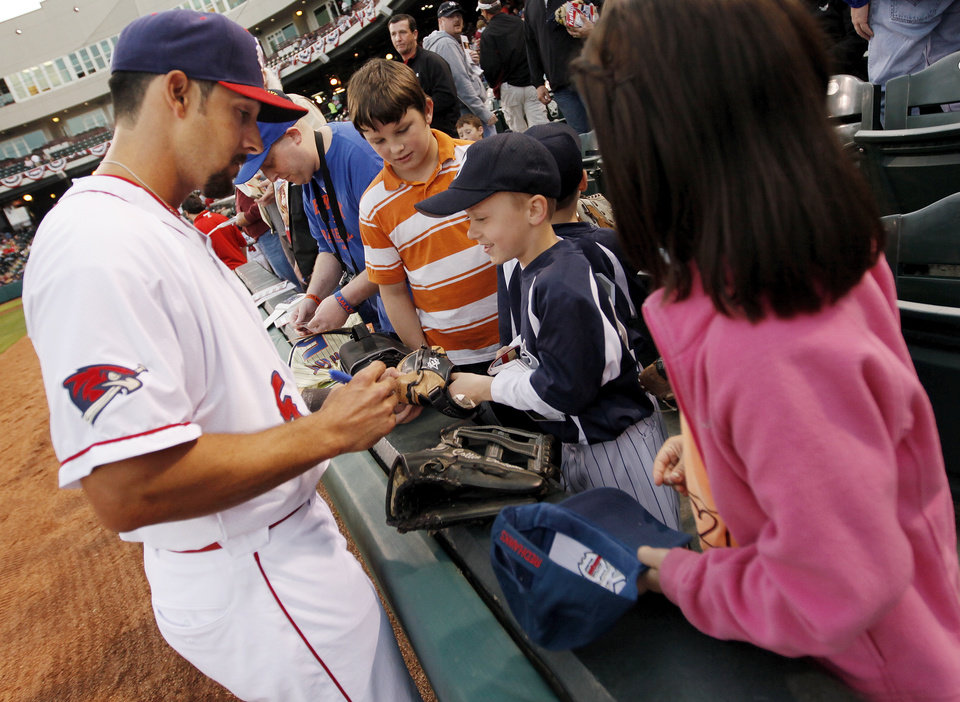Oklahoma City's Collin Delome (5) signs autographs before the 2012 opening day baseball game between the Oklahoma City RedHawks and the Memphis Redbirds at the Chickasaw Bricktown Ballpark in Oklahoma City, Thursday, April 5, 2012. Photo by Nate Billings, The Oklahoman